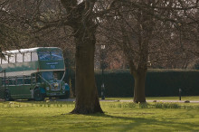 Green bus arriving at Offley place wedding venue